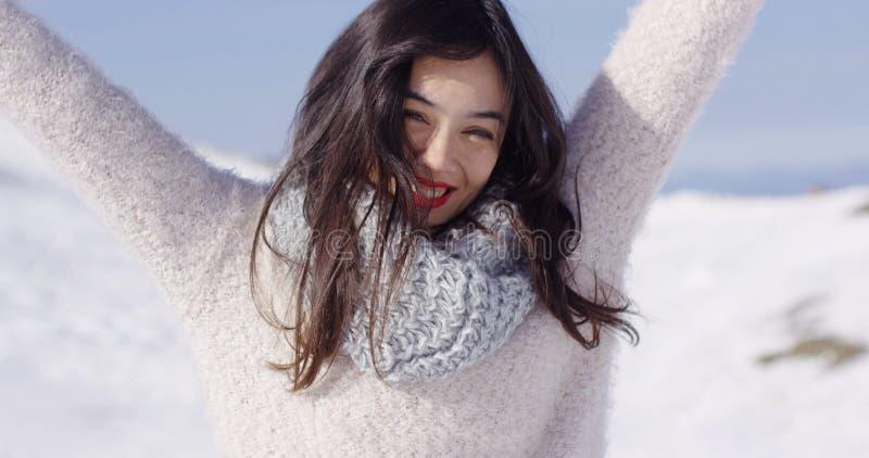 Happy young asian girl enjoys snowy winter stock photos