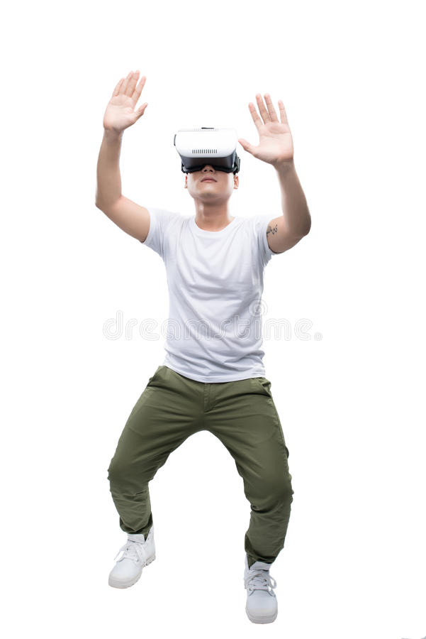 Happy young asian man using the virtual reality headset isolated stock images