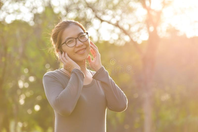 Asian woman is listening to the music. stock images