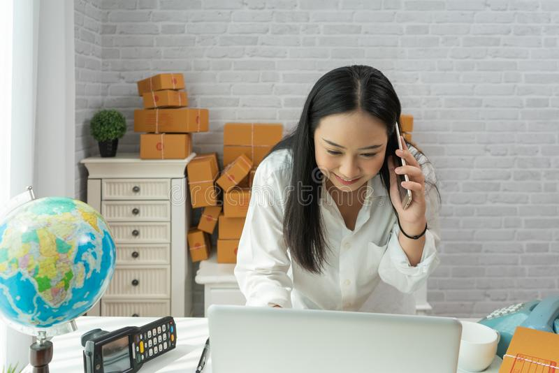 Happy young asian woman have a Small business enterprise concern royalty free stock photos