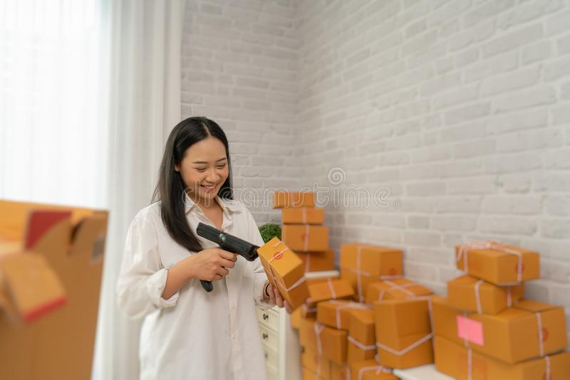 Happy young asian woman have a Small business enterprise concern stock images
