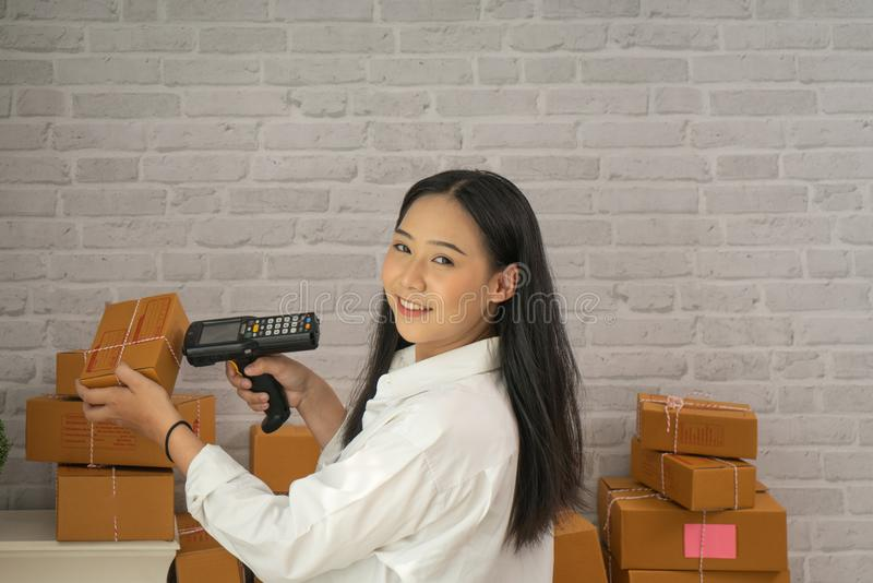Happy young asian woman have a Small business enterprise concern stock photo