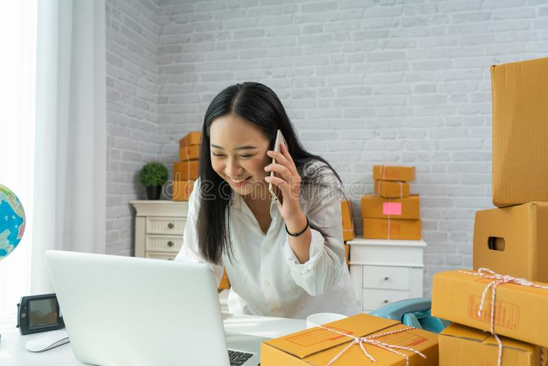 Happy young asian woman have a Small business enterprise concern stock photos