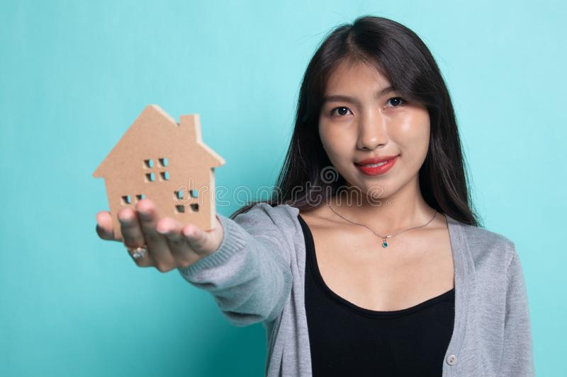 Happy young asian woman with house model royalty free stock photography