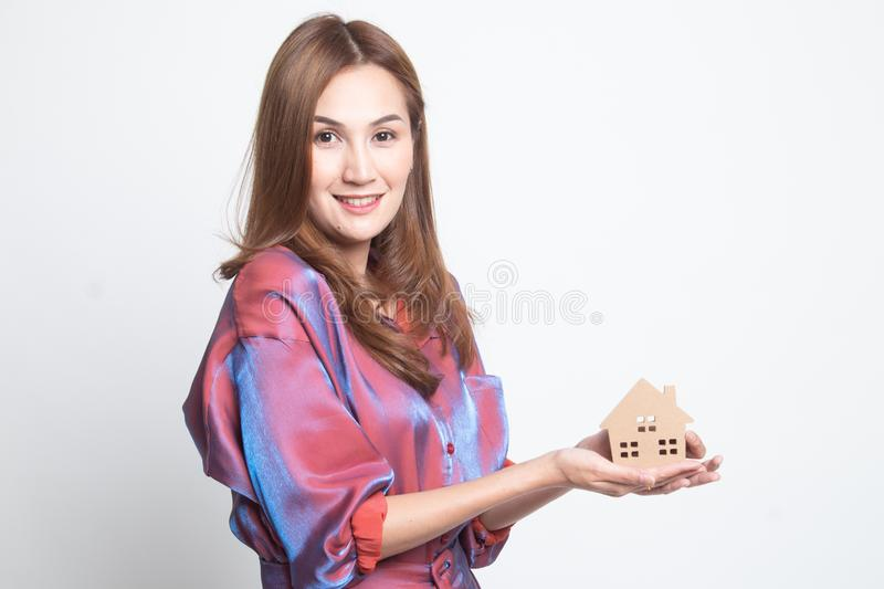 Happy young asian woman with house model stock photography