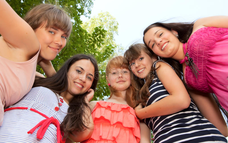 Download Happy Young And Attractive Girlfriends Stock Image - Image of brunette, green: 20143547