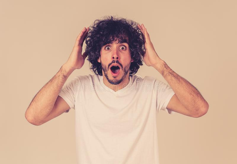 Happy young attractive man shocked with a surprised funny face. Human expressions and emotions royalty free stock photos