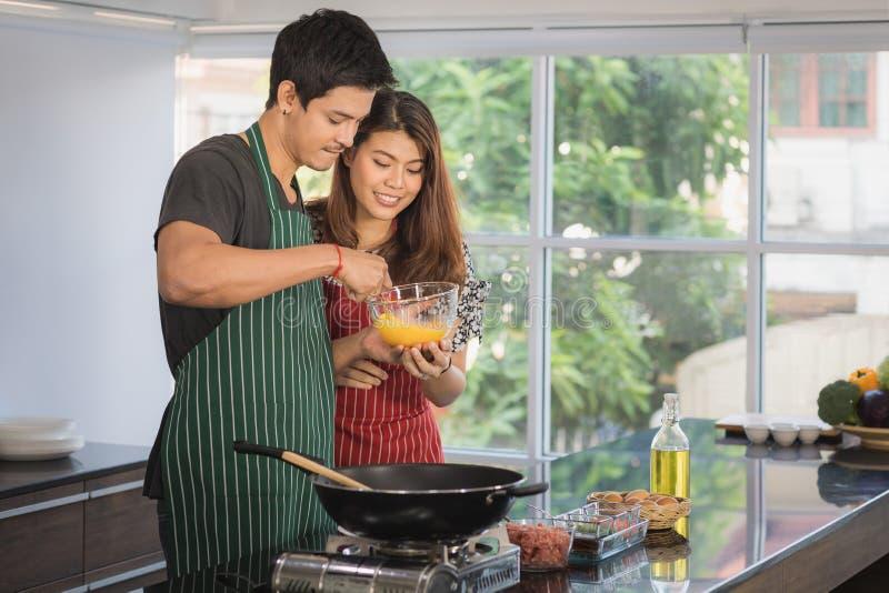 Asian couple at kitchen room stock photos