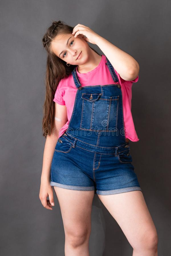 Happy young beautiful girl posing and looking to the c royalty free stock photography