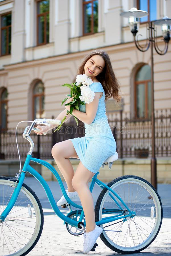 Attractive young woman enjoying riding her bicycle stock images