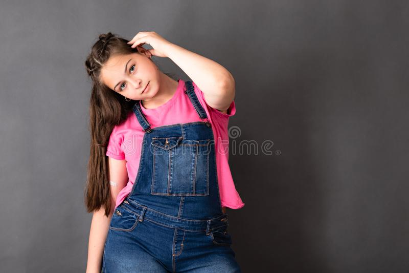 Happy young beautiful girl posing and looking to the c royalty free stock photo