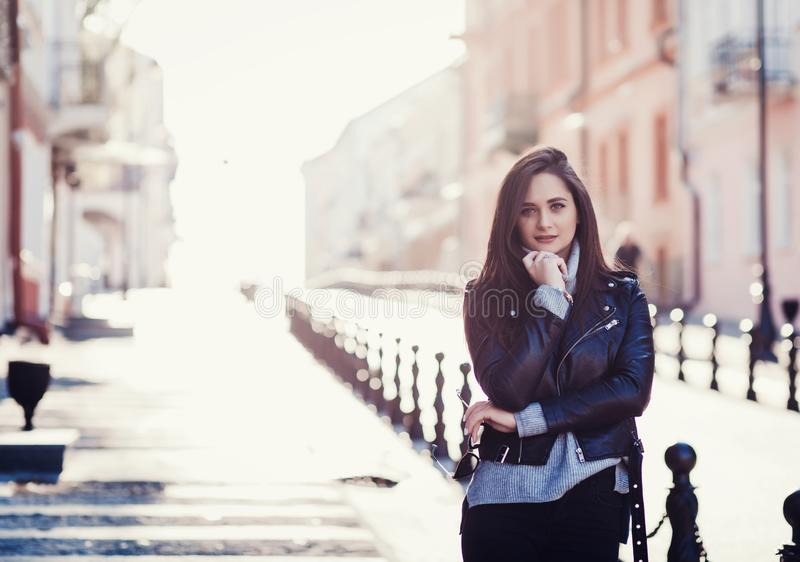 Happy young beautiful woman in city street royalty free stock photo