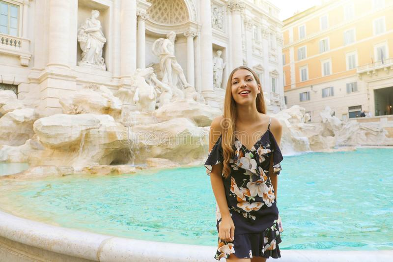 Happy young beautiful woman in Rome with Trevi Fountain. Holiday in Italy royalty free stock photo
