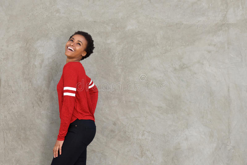 Happy young black woman laughing stock image
