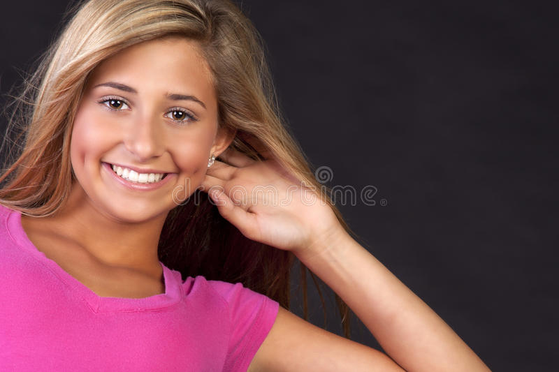 Happy young blond teen stock photos