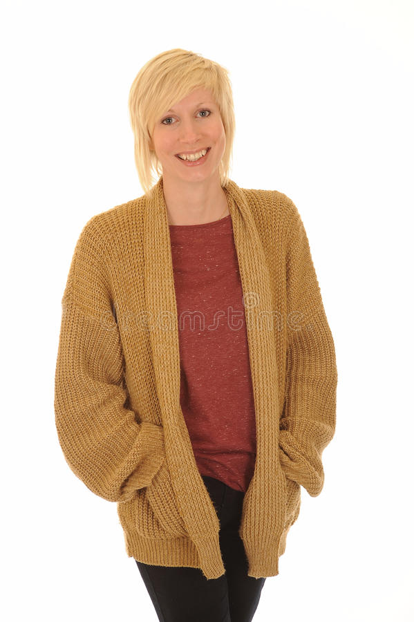 Happy young blond woman. Three quarter body portrait of attractive young blond woman with cardigan, isolated on white background royalty free stock photography