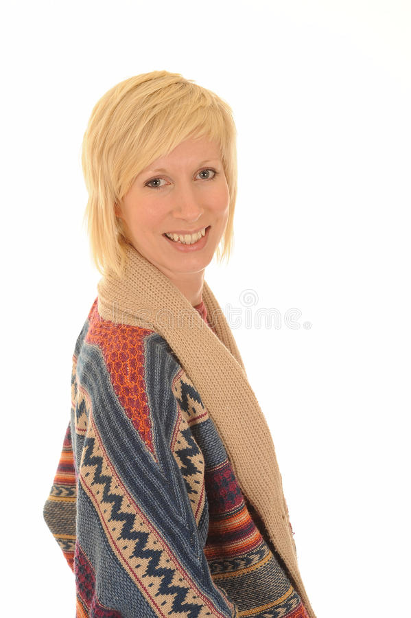 Happy young blond woman. Side portrait of happy young blond woman in colorful woolen cardigan looking over shoulder, isolated on white background royalty free stock photo