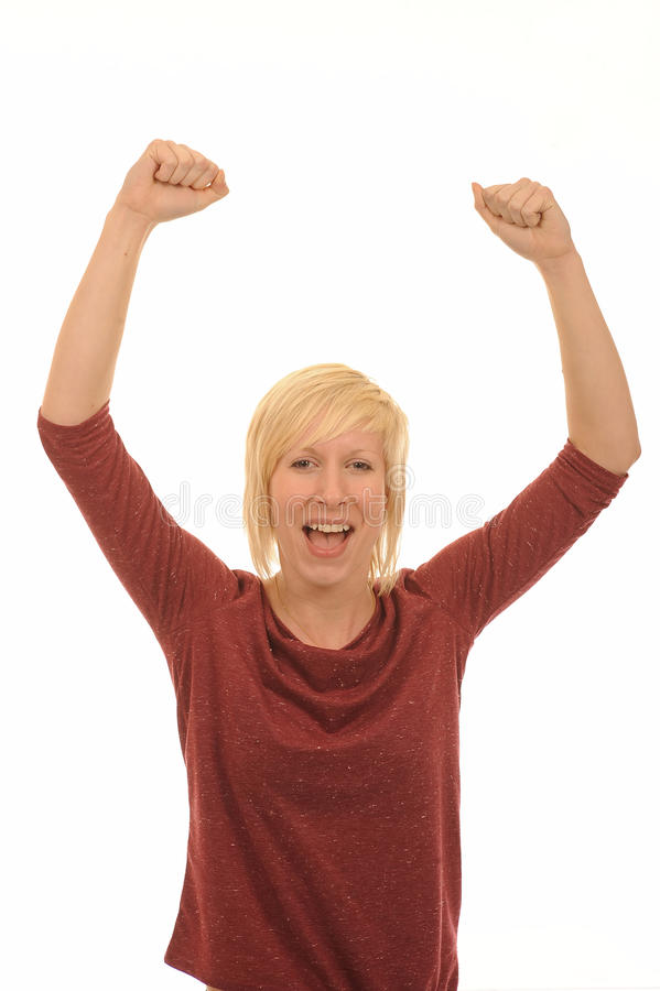 Happy young blond woman. Celebrating with arms in air, isolated on white background stock image