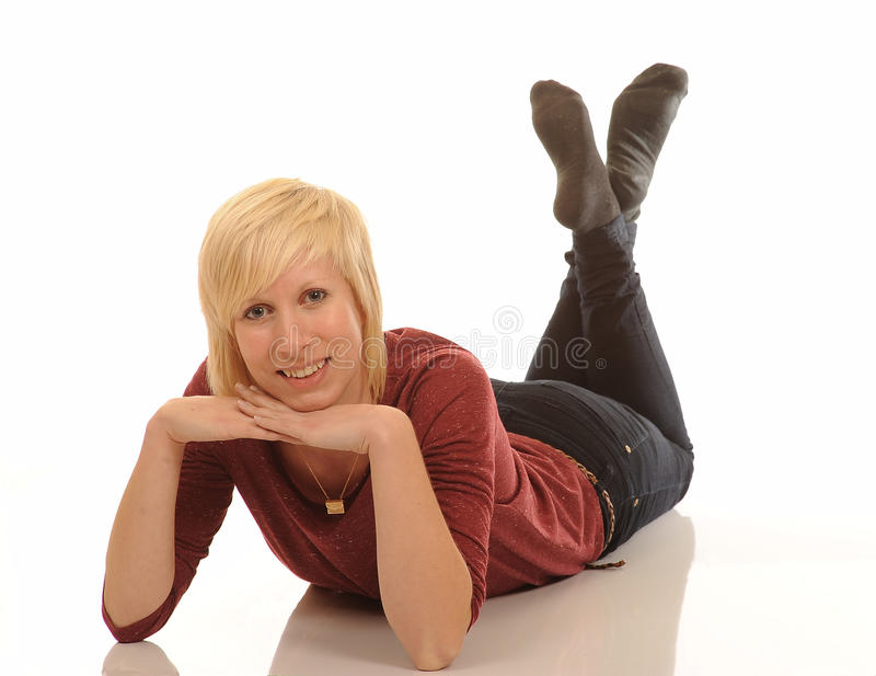 Happy young blond woman. Relaxing on white studio background royalty free stock photos