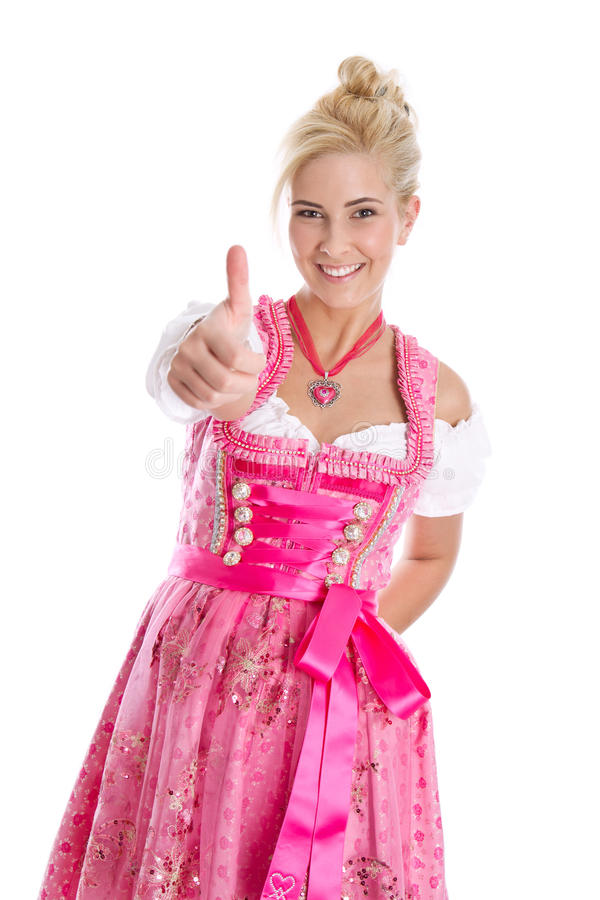 Happy young blond woman in dirndl dress in bavarian folkart. Happy young blond woman in dirndl dress in bavarian folkart - isolated over white royalty free stock photos