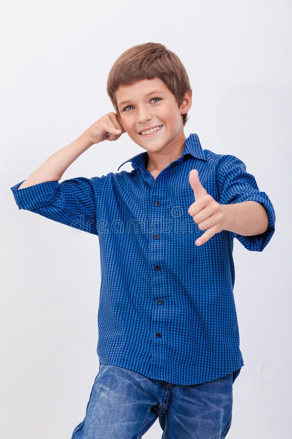 Happy young boy with calling gesture over white royalty free stock image