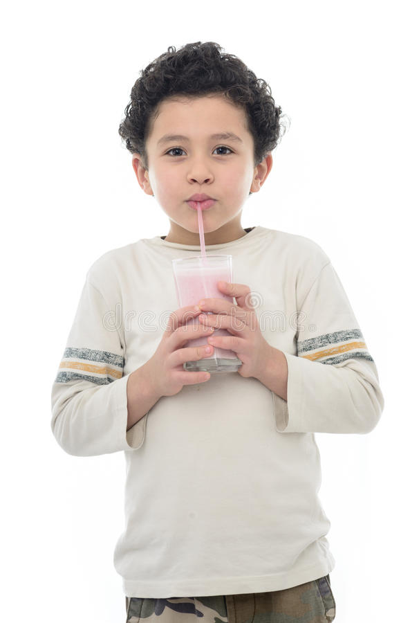 Happy Young Boy Drinking Milk Shake stock images