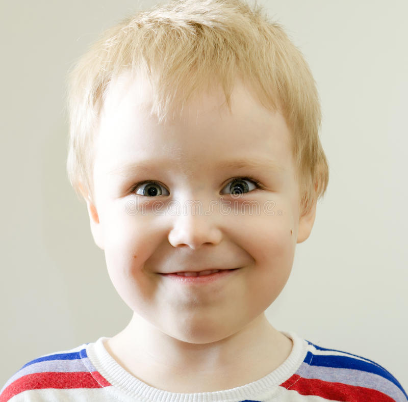 Happy young boy stock photo