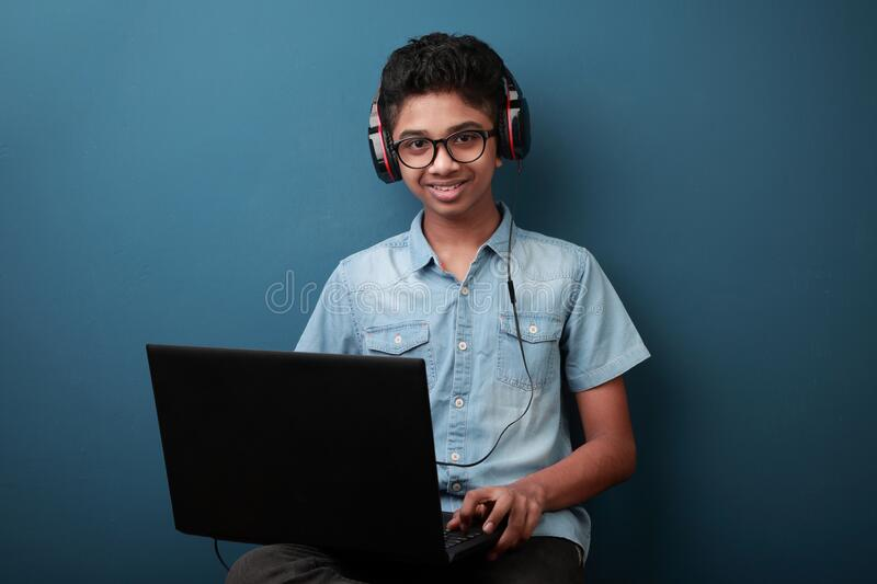 Happy young boy with laptop royalty free stock photos
