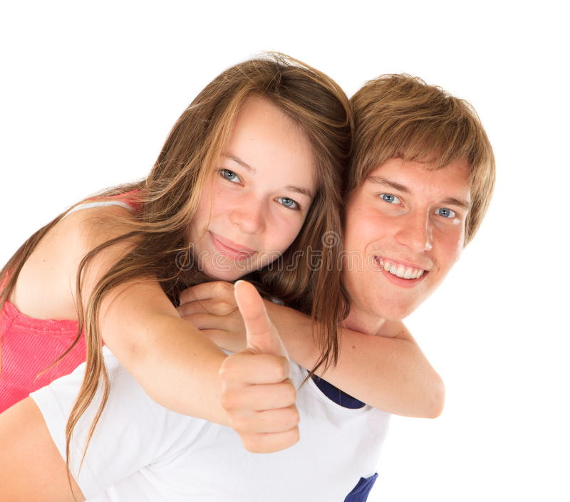 Happy young brother and sister. Happy young man with young sister on back with thumb up, white background stock photo