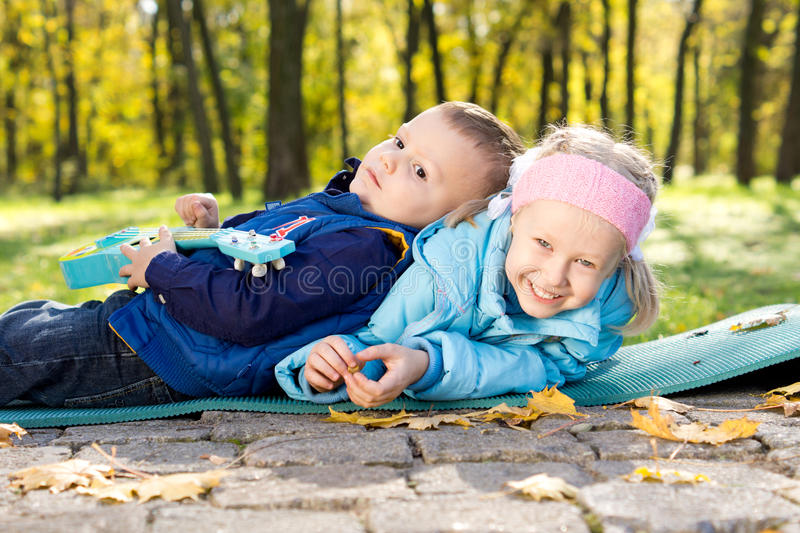 Happy young brother and sister playing stock images