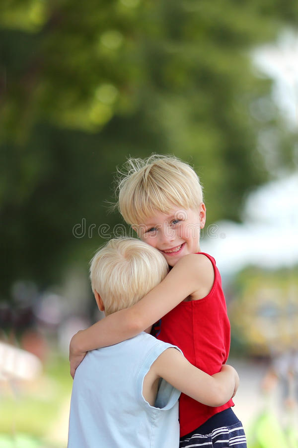 Happy Young Brothers Hug Outside royalty free stock images