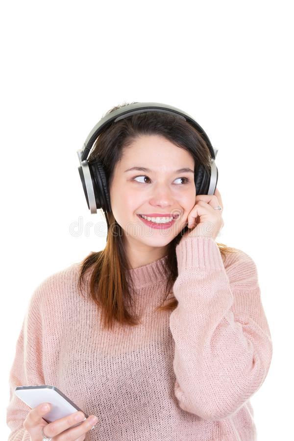Happy young brunette woman with headphones on white background stock photos