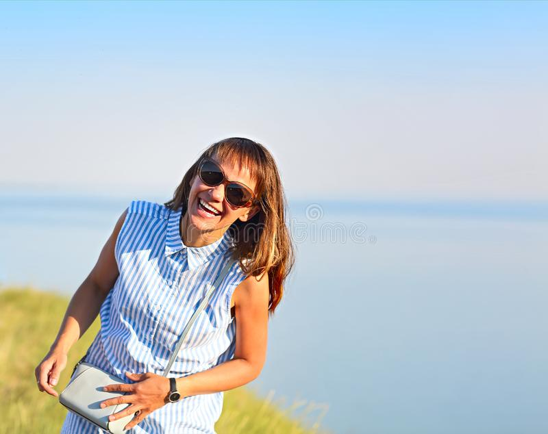 Happy young brunette woman open smile by the sea royalty free stock images