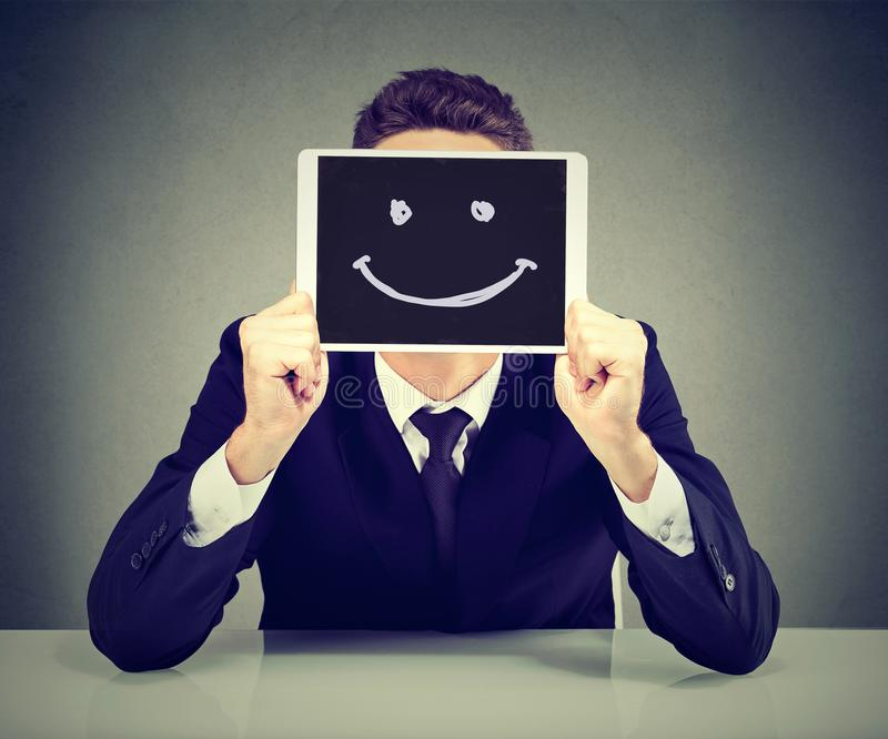 Happy young business man with tablet computer royalty free stock photo