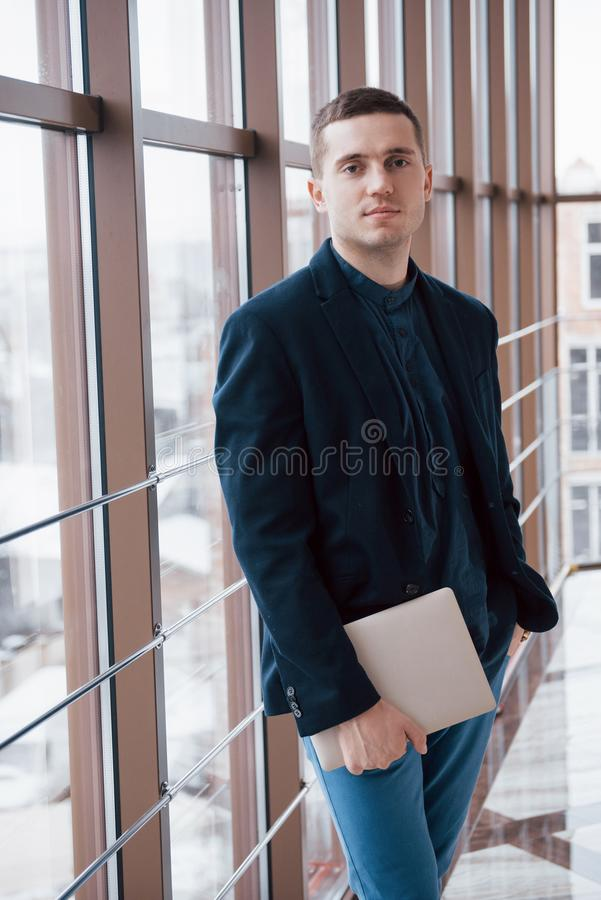 Happy young business man work in modern office on computer stock image