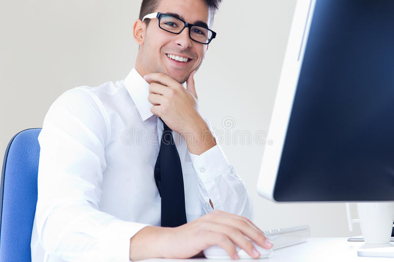 Happy young business man work in modern office on computer stock images