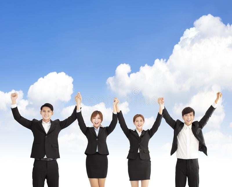 Happy business people celebrating their teamwork stock image