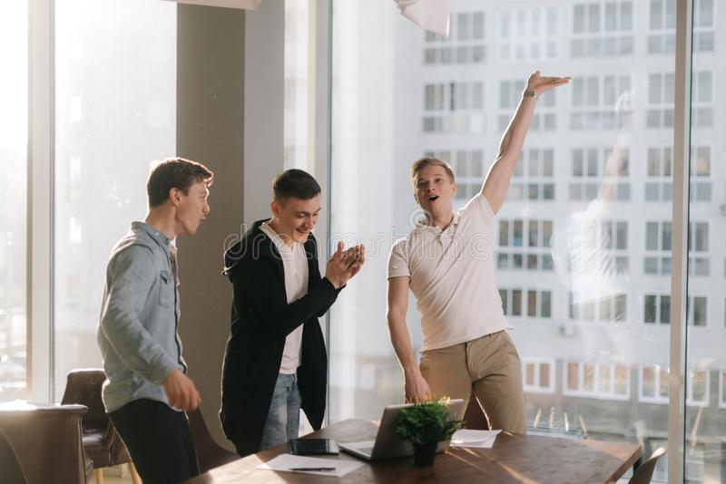 Happy young business team are celebrating the successful conclusion royalty free stock photography