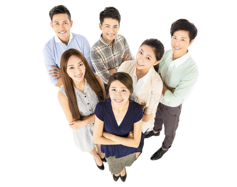 Happy young business team standing together royalty free stock photo