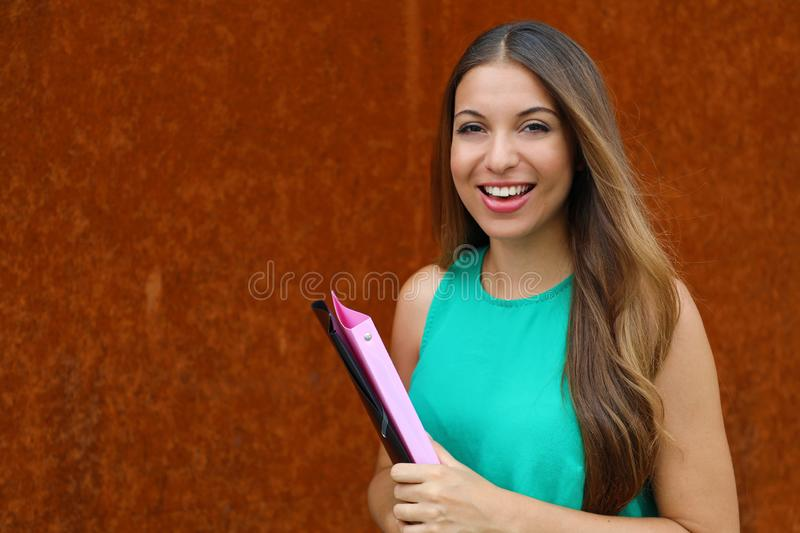 Happy young business woman holding folders outdoor with copy space.  royalty free stock photos