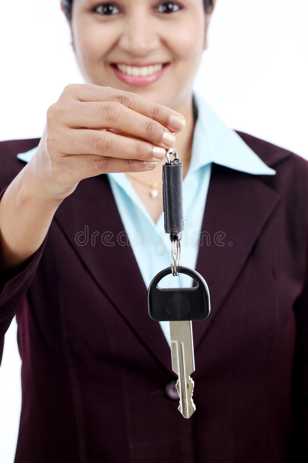 Happy young business woman holding key stock photography