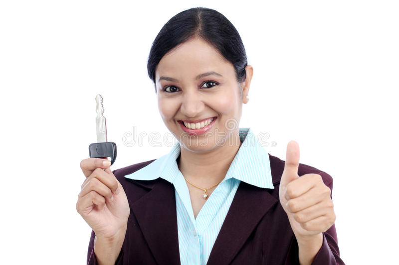 Happy young business woman holding key stock images