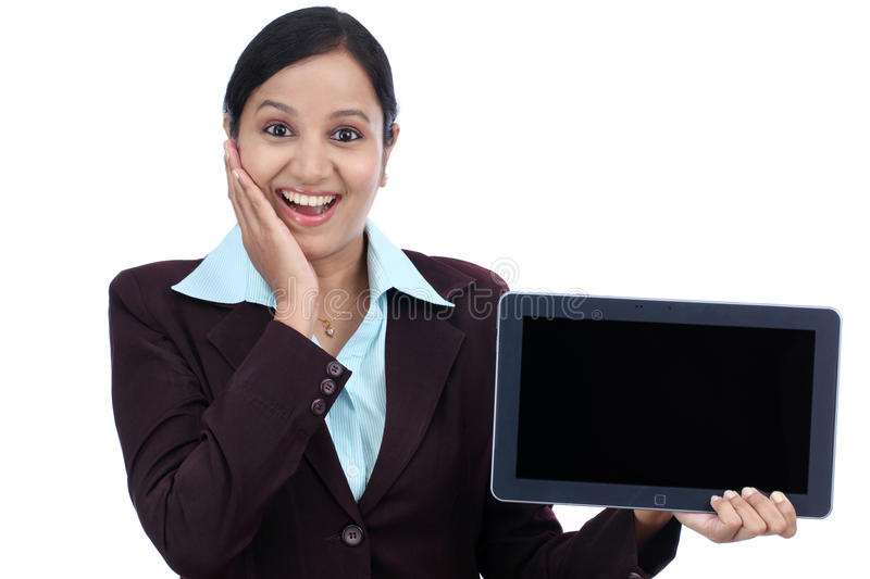 Happy young business woman showing tablet royalty free stock photography