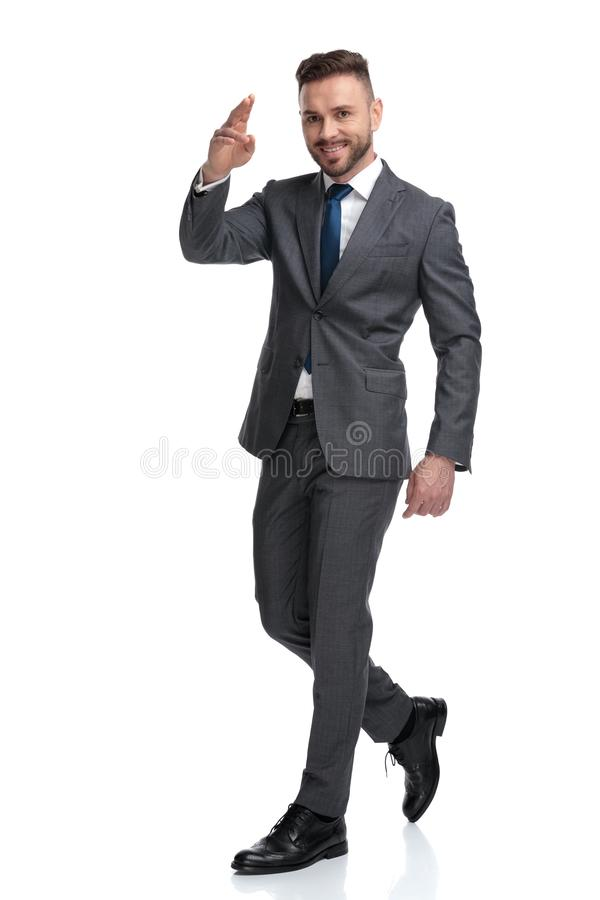 Happy young businessman giving a military salute while walking stock images