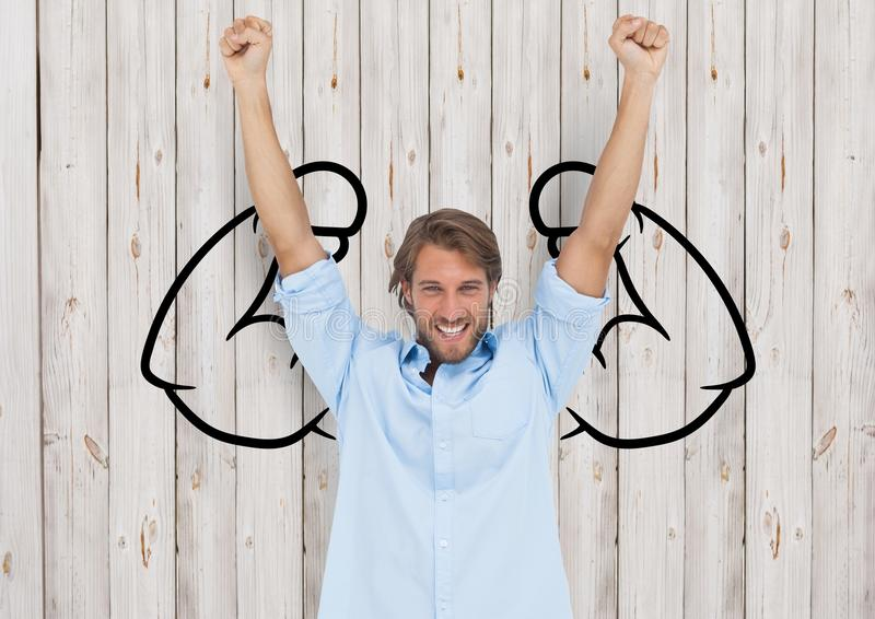 happy young businessman hands up in front of fists draw on wood wall stock images