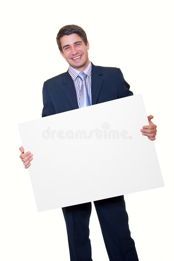 Happy young businessman holding blank white card royalty free stock image