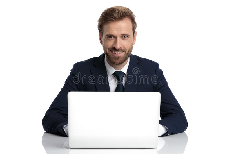 Happy young businessman in navy blue suit smiling stock images