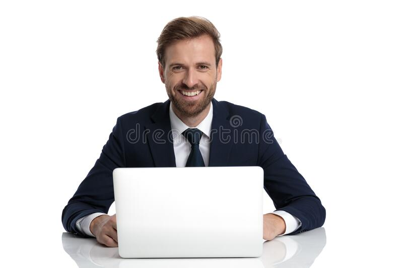 Happy young businessman in navy blue suit smiling stock photo