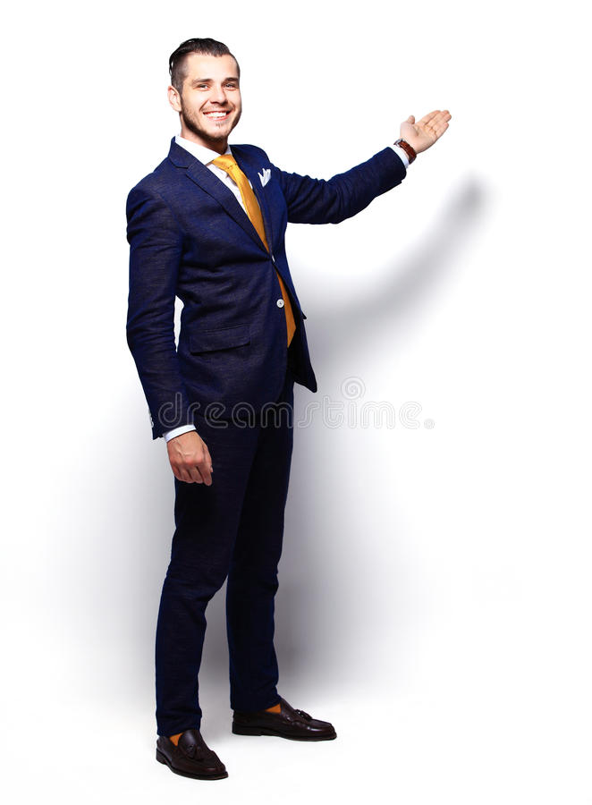 Happy Young Businessman Presenting Isolated Over White stock photography