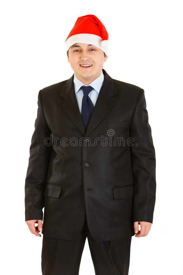 Happy young businessman in Santa hat isolated royalty free stock image